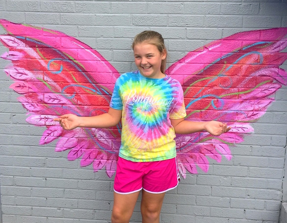 Ridgely Coleman is among the first to have her photograph under the angel wing wall mural in Richmond