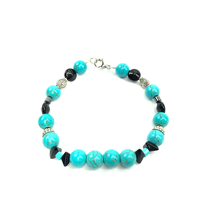 Turquoise tundra bracelet with silver and black accents