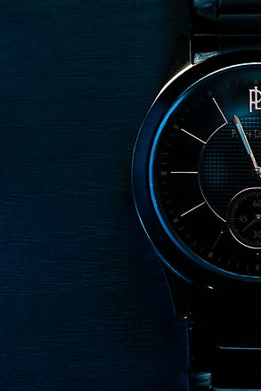 Watch products picture, with blue light, and wood.
