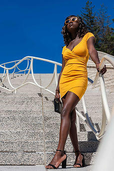 "Murielle with sunglasses at the ""Natural history museum"" of Canada at Gatineau. with a Yellow dress and beautiful legs"