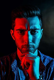 Darren with red and blue light split on his face