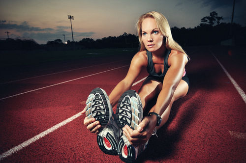 Adidas track and field girl photoshoot stretching athletic wear