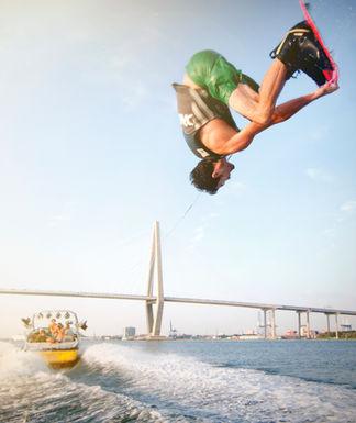 Ronix liquid force and hyperlite athlete behind boat commercial photoshoot charleston bridge
