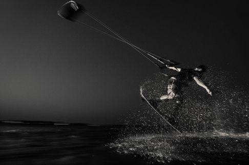 kiteboarder at night lit by strobe flysurfer cabrinha best liquid force