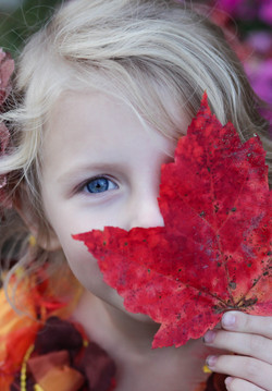 Young girl with leaf