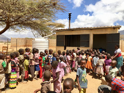 Kids queuing for lunch at Calleri ECDC