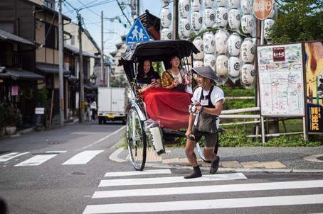 Tourists in a rickshaw, Kyoto, Japan, 2018.