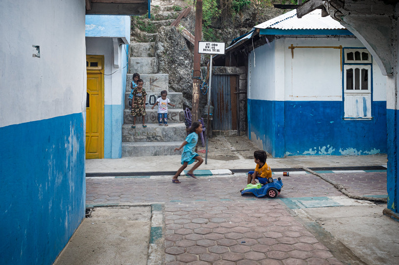 Children playing in the street, Tual, Indonesia, 2019.