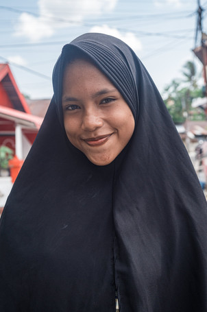 Young girl smiling, Tual, Indonesia, 2019.