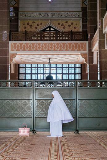 Woman praying, Putrajaya, Malaysia, 2020.