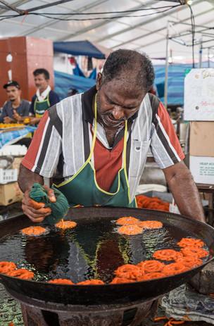 Man preparing Jalebi, Kuala Lumpur, Malaysia, 2020.