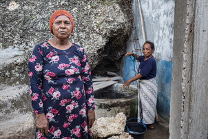Two women at the water well, Tual, Indonesia, 2019.