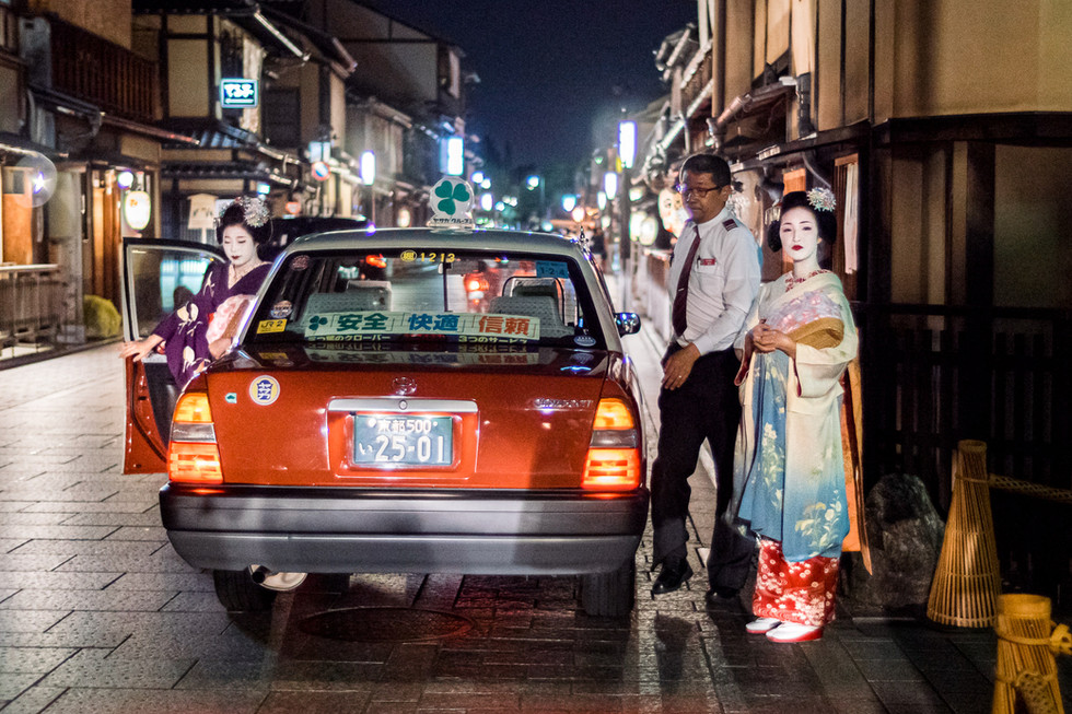 Maikos leaving a taxi, Gion, Kyoto, Japan, 2018.