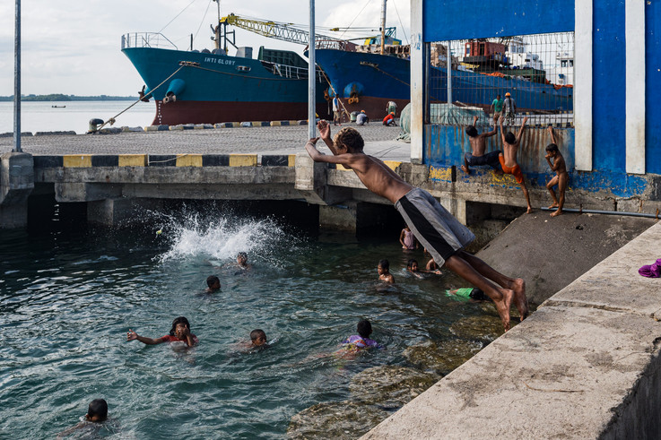 Children playing in the harbor, Tual, Indonesia, 2019.