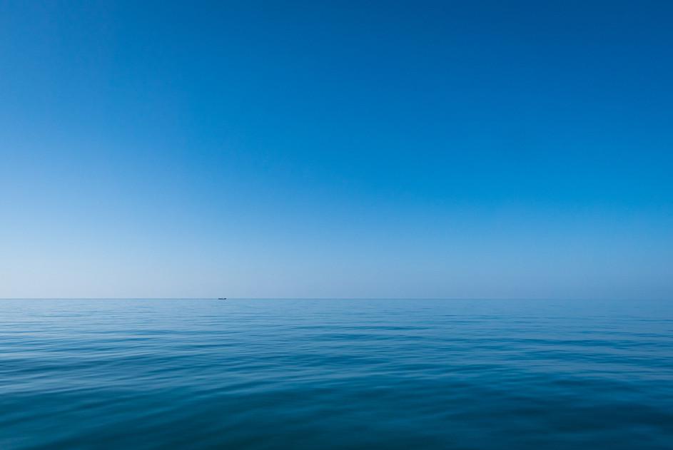 Fisherman boat in blue, Indonesia, 2019.