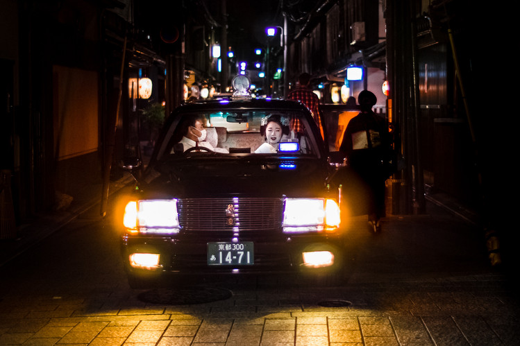 Smiling Maiko in a taxi, Gion, Kyoto, Japan, 2018.