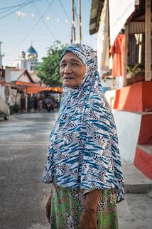 Old woman wearing a Hijab, Tual, Indonesia, 2019.