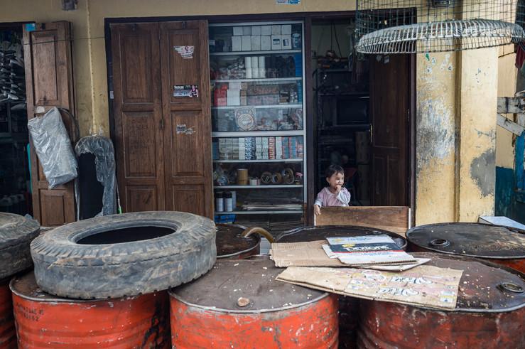 Little girls in diesel shops, Tual, Indonesia, 2019.