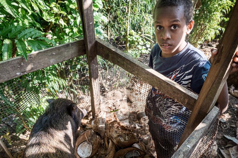 Balza and the pig, Santo Island, Vanuatu, 2019.