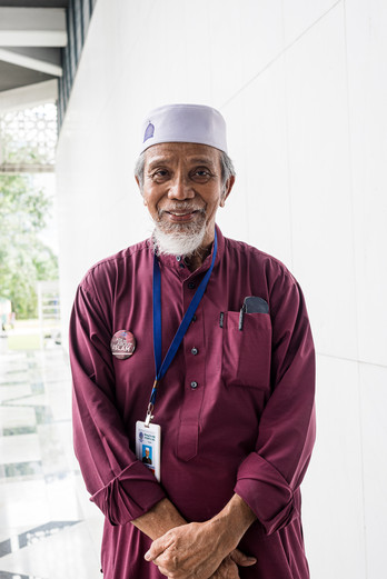 Guide at blue mosque, Malaysia, 2020.