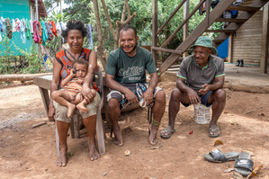 Lyne, her husband, their son and the house guard, Port Moresby, Papua New Guinea, 2019.