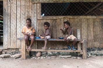 Children eating, Hog Harbour, Vanuatu, 2019.
