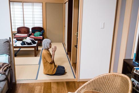 Fumie praying for her husband, Tokyo, Japan, 2019.