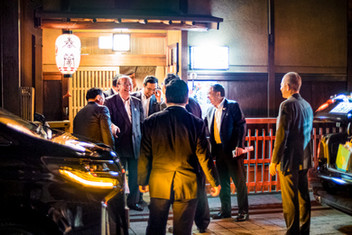 Groups of men leaving a restaurant, Gion, Kyoto, Japan, 2018.