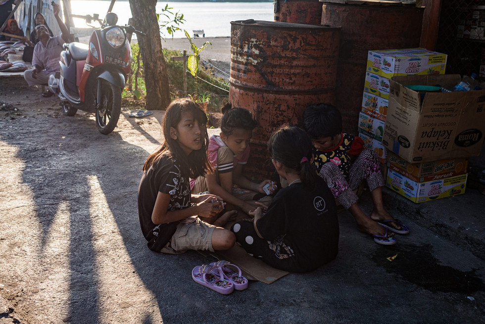 Children playing cards, Tual, Indonesia, 2019.