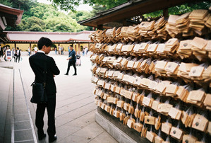 Man looking at Ema in a temple, Tokyo, Japan, 2019.