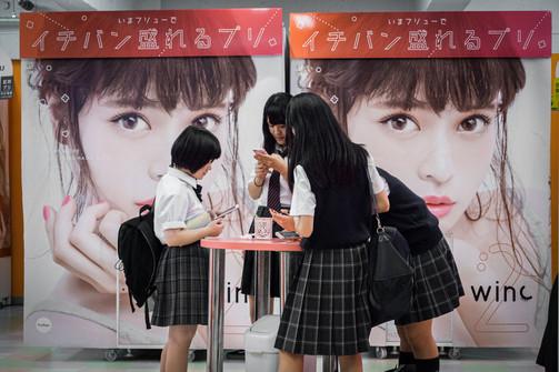 Group of teenagers in Purikura, Tokyo, Japan, 2018.