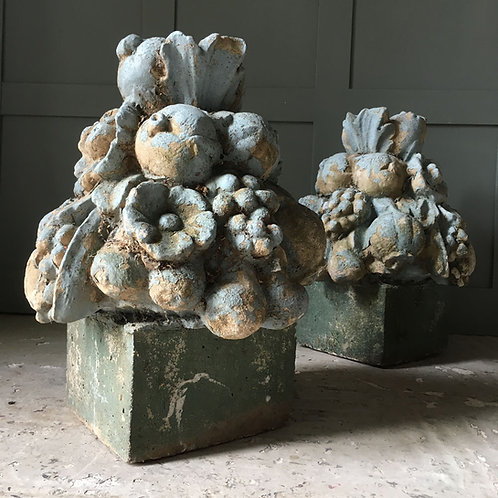 Pair of weathered garden ornaments
