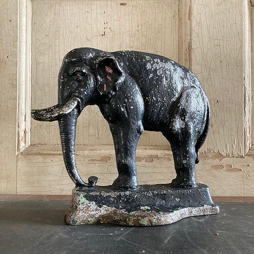 SOLD - Antique elephant door stop porter