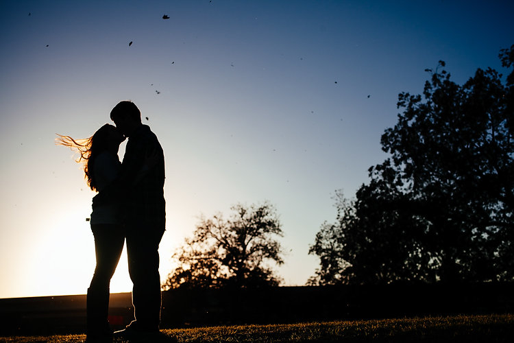 Silhouetted windy engagement portrait by Mary Cyrus Photography in McKinney, TX
