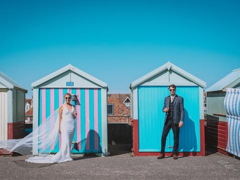 Bride and groom portrait - beach huts