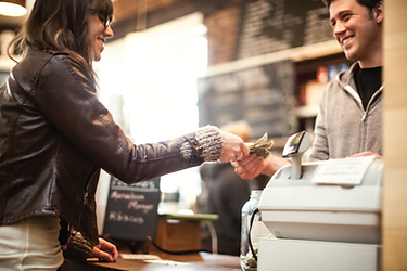 A cash transaction in a cafe.