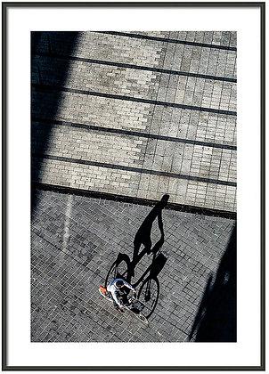Cyclist On The Plaza Framed