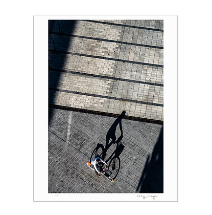 Cyclist On The Plaza Print