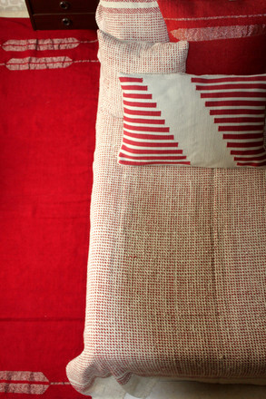 HANDSPUN BEDCOVER AND SMALL CUSHIONS ALONG WITH HANDWOVEN RUGS AND BIG CUSHIONS