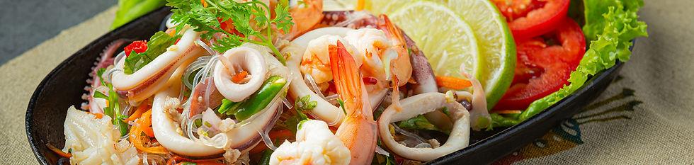 spicy-mixed-seafood-salad-with-thai-food2100X500.jpg