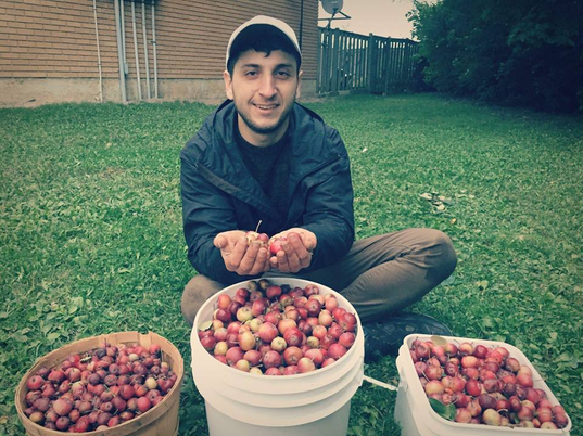 Nic with Apples.png