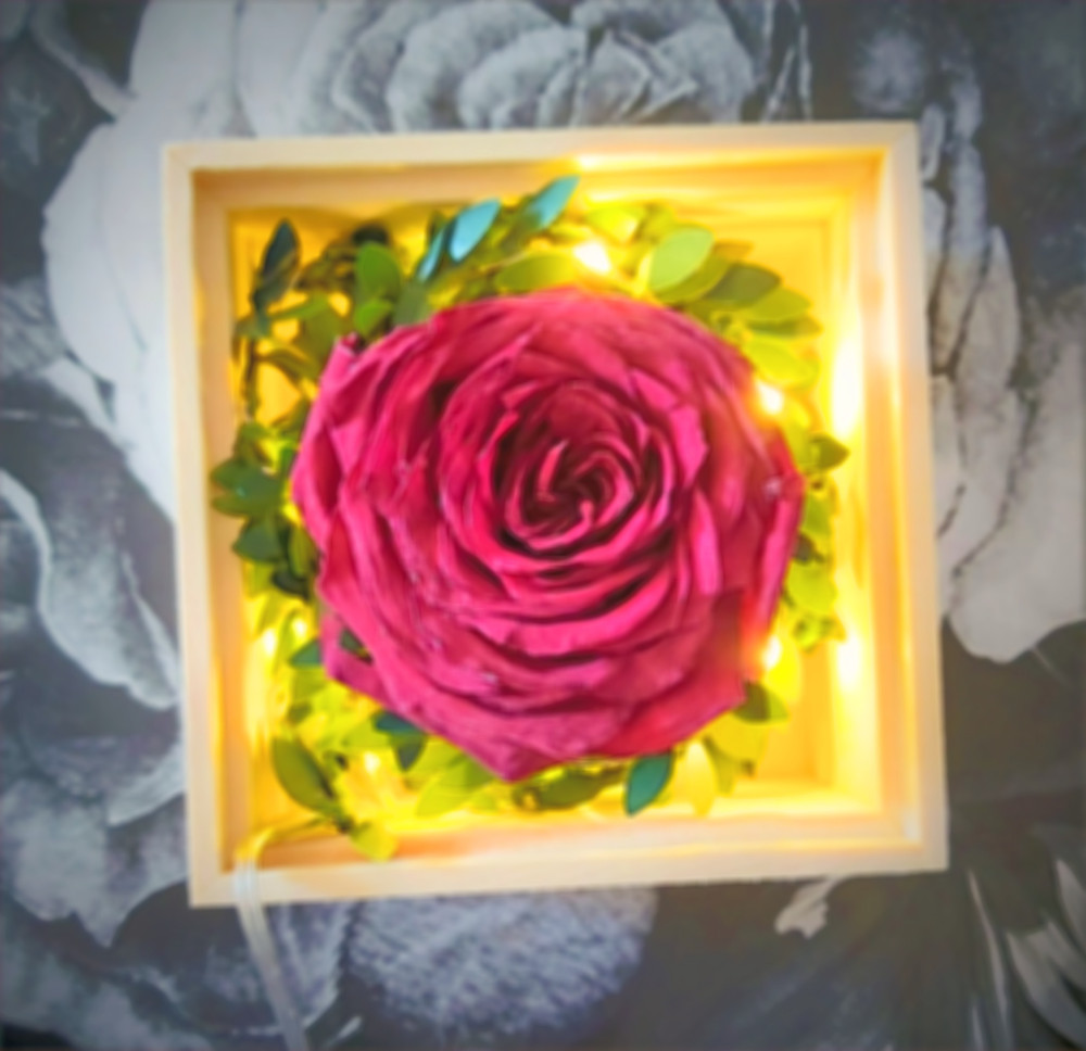Rose with fairy light in wooden box