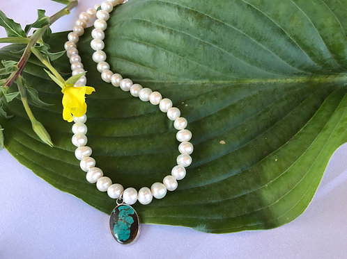 Hand knotted pearl necklace with turquoise pendant