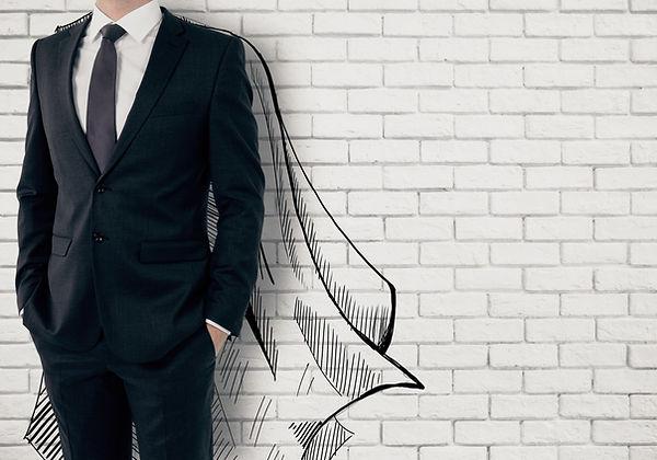 Businessman with drawn cape on white bri