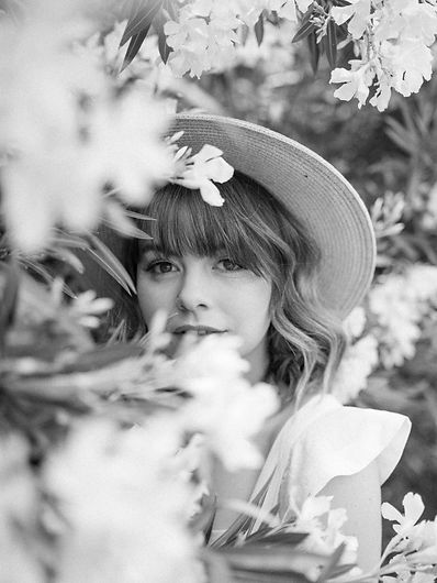 Emily Bridgman is a Fine Art photographer and story teller. She loves romance and genuinely believes she was devinely created to capture your love story.