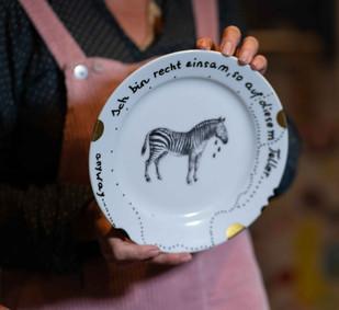 Teller mit Zebra