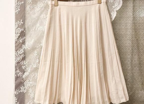 米白百褶裙