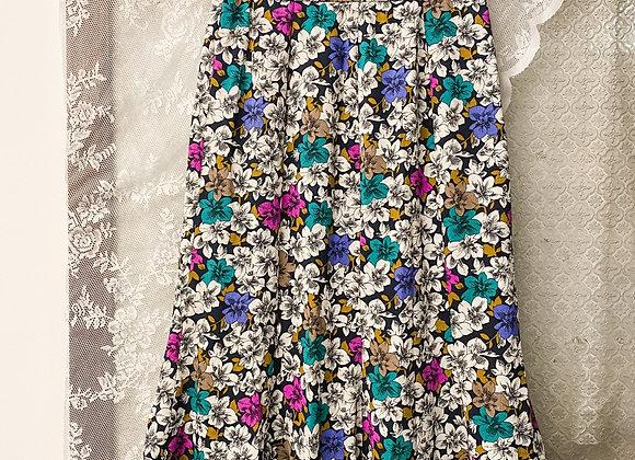 黑底白紫綠花A字裙