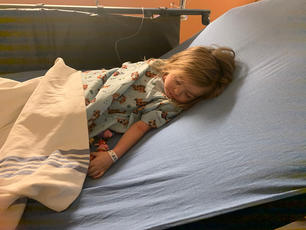 Young child who is sick, laying in a hospital bed. I gave up my child's healing today.