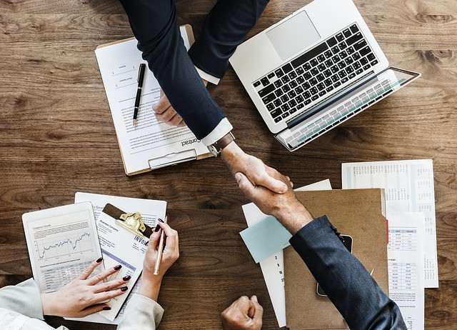 Business people shaking hands to solidify promotion
